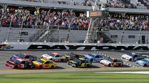 Austin Dillon (3) and Denny Hamlin (11) lead the pack to start the NASCAR Clash auto race at Daytona International Speedway, Sunday, Feb. 11, 2018, in Daytona Beach, Fla. (AP Photo/Terry Renna)