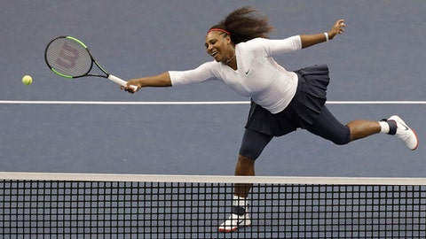 USA's Serena Williams reaches for a shot against the Netherlands during a doubles match in the first round of Fed Cup tennis competition in Asheville, N.C., Sunday, Feb. 11, 2018. (AP Photo/Chuck Burton)