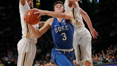 Duke guard Grayson Allen (3) drives between Georgia Tech's Tadric Jackson (1) and Ben Lammers (44) during an NCAA college basketball game Sunday, Feb. 11, 2018, in Atlanta. (AP Photo/John Bazemore)