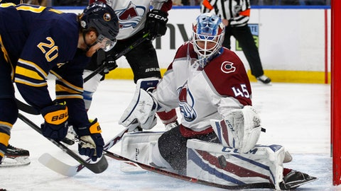 Buffalo Sabres forward Scott Wilson (20) is stopped by Colorado Avalanche goalie Jonathan Bernier (45) during the second period of an NHL hockey game, Sunday, Feb.11, 2018, in Buffalo, N.Y. (AP Photo/Jeffrey T. Barnes)