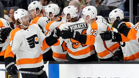 Philadelphia Flyers center Sean Couturier shakes hands with the bench after a goal during the second period of an NHL hockey game against the Vegas Golden Knights Sunday, Feb. 11, 2018, in Las Vegas. (AP Photo/Isaac Brekken)