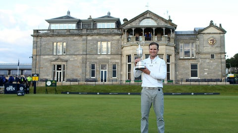 FILE - A Monday, July 20, 2015 file photo of United States' Zach Johnson posing with the claret jug trophy after winning a playoff after the final round at the British Open Golf Championship at the Old Course, St. Andrews, Scotland. The British Open is returning to the home of golf in 2021. The Old Course will host the 150th anniversary of the worlds oldest major to mark a true celebration of golfs original championship and its historic ties to St Andrews, the R&A said Monday, Feb. 12, 2018. (AP Photo/Peter Morrison, File)