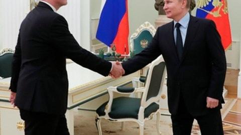 Russian President Vladimir Putin, right, greets FIFA president Gianni Infantino during their meeting in the Kremlin in Moscow, Russia, Monday, Feb. 12, 2018. (Mikhail Klimentyev/Pool Photo via AP)
