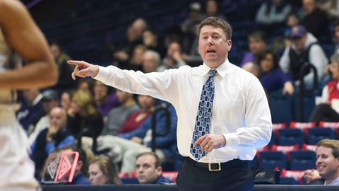 In this Jan. 4, 2018, photo provided by Belmont University, Belmont women's basketball coach Bart Brooks directs his team in an NCAA basketball game against Tennessee Tech in Nashville, Tenn. Belmont is in the AP Top 25 for the first time in school history. The Bruins (24-3) entered The Associated Press women's basketball poll Monday, Feb. 12, 2018, at No. 24. (Sam Simpkins/Belmont University via AP)