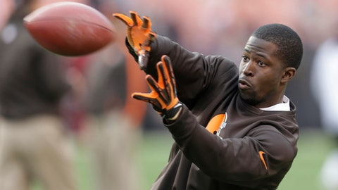 FILE - This Dec. 16, 2012 file photo shows Cleveland Browns wide receiver Mohamed Massaquoi warming up before the Browns play the Washington Redskins in an NFL football game in Cleveland. Massaquoi revealed for the first time that he lost most of his left hand in an ATV accident last April. Massaquoi, who starred at Georgia before going to the NFL, was riding with friends when he crashed and was badly injured. Doctors attempted to save his hand, but were only able to keep his thumb. (AP Photo/Tony Dejak, file)