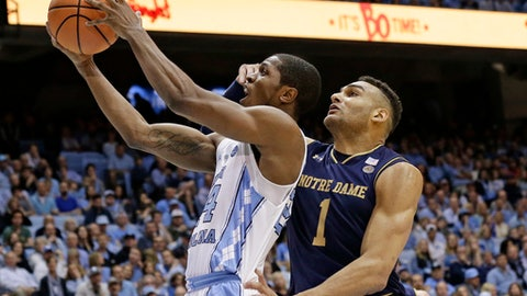 North Carolina's Kenny Williams drives for a shot while Notre Dame's Austin Torres (1) defends during the first half of an NCAA college basketball game in Chapel Hill, N.C., Monday, Feb. 12, 2018. (AP Photo/Gerry Broome)