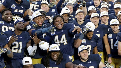 Notre Dame players celebrate after winning the Citrus Bowl NCAA college football game against LSU 21-17, Monday, Jan. 1, 2018, in Orlando, Fla. (AP Photo/John Raoux)