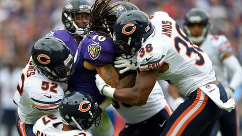 Baltimore Ravens wide receiver Chris Moore (10) is tackled by Chicago Bears defenders as he rushes the ball in the second half of an NFL football game, Sunday, Oct. 15, 2017, in Baltimore. (AP Photo/Nick Wass)