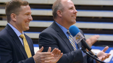 South Dakota State's new mens basketball coach T.J. Otzelberger, left, and athletic director Justin Sell clap during a school cheer at a ceremony introducing Otzelberger, Thursday, April 14, 2016, at Frost Arena in Brookings, South Dakota. Otzelberger replaces longtime head coach Scott Nagy, who took a head coaching job at Wright State. (AP Photo/Dirk Lammers)