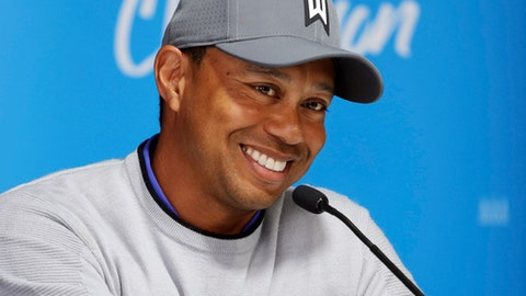 Tiger Woods talks about his charitable works off the course and his return to competitive golf in the Genesis Open at Riviera Country Club after an absence of 12 years, at the course in the Pacific Palisades area of Los Angeles Tuesday, Feb. 13, 2018. (AP Photo/Reed Saxon)