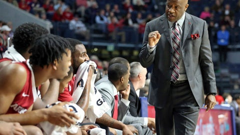 Arkansas forward Mike Anderson celebrates talks to players during the team's NCAA college basketball game against Mississippi in Oxford, Miss., Tuesday, Feb. 13, 2018. (Petre Thomas/The Oxford Eagle via AP)