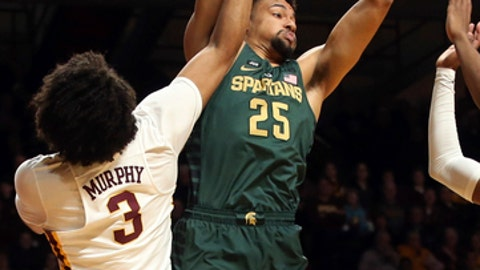 Michigan State's Kenny Goins, right, pulls in a rebound next to Minnesota's Jordan Murphy during the first half of an NCAA college basketball game Tuesday, Feb. 13, 2018, in Minneapolis. (AP Photo/Jim Mone)