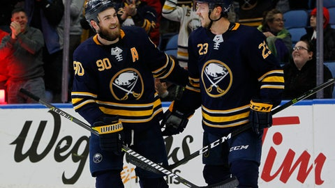 Buffalo Sabres' Ryan O'Reilly (90) and Sam Reinhart (23) celebrate Reinhart's goal against the Tampa Bay Lightning during the third period of an NHL hockey game Tuesday, Feb. 13, 2018, in Buffalo, N.Y. (AP Photo/Jeffrey T. Barnes)
