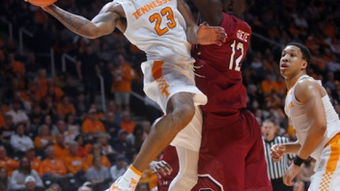 Tennessee guard Jordan Bowden (23) is defended by South Carolina forward Khadim Gueye (12) during the first half of an NCAA college basketball game Tuesday, Feb. 13, 2018, in Knoxville, Tenn. (AP Photo/Crystal LoGiudice)