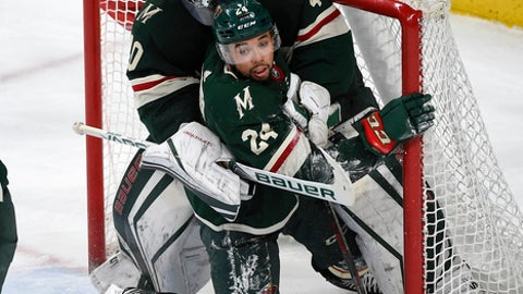 Minnesota Wild defenseman Matt Dumba (24) collides with goalie Devan Dubnyk (40) during the third period of the team's NHL hockey game against the New York Rangers on Tuesday, Feb. 13, 2018, in St. Paul, Minn. Minnesota won 3-2. (AP Photo/Craig Lassig)