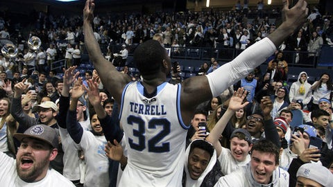 Rhode Island's Jared Terrell (32) celebrates with the students after defeating Richmond in an NCAA college basketball game Tuesday, Feb. 13, 2018, in Kingston, R.I. (AP Photo/Stew Milne)