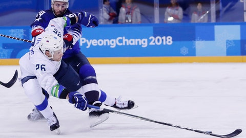 Jonathon Blum (24), of the United States, defends Jan Urbas (26), of Slovenia, during the first period of the preliminary round of the men's hockey game at the 2018 Winter Olympics in Gangneung, South Korea, Wednesday, Feb. 14, 2018. (AP Photo/Frank Franklin II)