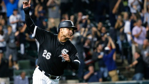 FILE - In this Aug. 23, 2017, file photo, Chicago White Sox's Avisail Garcia celebrates after scoring the game-winning run on a single by Tim Anderson during the ninth inning of a baseball game against the Minnesota Twins, in Chicago. Chicago White Sox outfielder Avisail Garcia is ging to salary arbitration. Garcia requested a hike from $3 million to $6.7 million rather than Chicago's $5.85 million offer. (AP Photo/Charles Rex Arbogast, File)