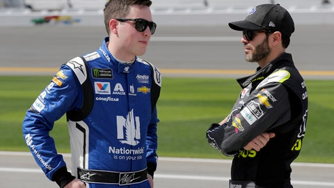 In this Sunday, Feb. 11, 2018, photo, Alex Bowman, left, and Jimmie Johnson talk on pit road before qualifying for the NASCAR Daytona 500 auto race at Daytona International Speedway, in Daytona Beach, Fla.  Hendrick Motorsports had a strong opening to Speedweeks by putting Alex Bowman on the pole for the Daytona 500. The team owner doesn't believe the rest of the season will be so easy. (AP Photo/Terry Renna)