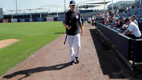 New York Yankees manager Aaron Boone walks on the field at baseball spring training camp, Wednesday, Feb. 14, 2018, in Tampa, Fla. (AP Photo/Lynne Sladky)