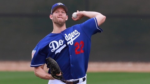 Los Angeles Dodgers starting pitcher Clayton Kershaw throws at the team's spring training baseball facility Wednesday, Feb. 14, 2018, in Glendale, Ariz. Kershaw has already been tabbed for a record eighth start on opening day for the Dodgers. The rest of the rotation is also familiar for the defending NL champions, even without Yu Darvish, after coming up one win short of a World Series title last season.(AP Photo/Carlos Osorio)