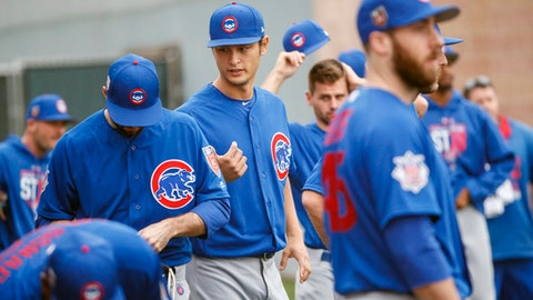 Chicago Cubs pitcher Yu Darvish, center, talks with other players at baseball spring training in Mesa, Ariz., Wednesday, Feb. 14, 2018.  (Armando L. Sanchez/Chicago Tribune via AP)