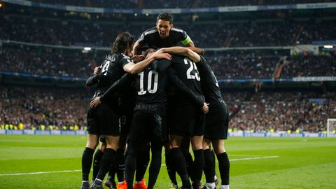 PSG' players celebrate after scoring the opening during the Champions League soccer match, round of 16, 1st leg between Real Madrid and Paris Saint Germain at the Santiago Bernabeu stadium in Madrid, Spain, Wednesday, Feb. 14, 2018. (AP Photo/Paul White)