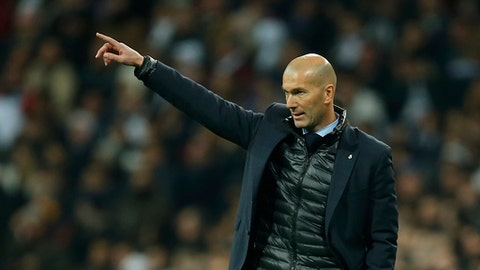 Real Madrid coach Zinedine Zidane gives instructions to his players during the Champions League soccer match, round of 16, 1st leg between Real Madrid and Paris Saint Germain at the Santiago Bernabeu stadium in Madrid, Spain, Wednesday, Feb. 14, 2018. (AP Photo/Paul White)