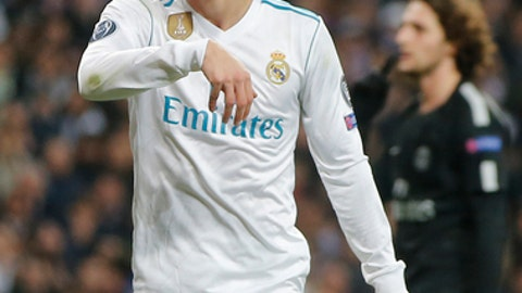 Real Madrid's Toni Kroos reacts during the Champions League soccer match, round of 16, 1st leg between Real Madrid and Paris Saint Germain at the Santiago Bernabeu stadium in Madrid, Spain, Wednesday, Feb. 14, 2018. (AP Photo/Paul White)