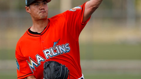 Miami Marlins pitcher Wei-Yin Chen throws during spring training baseball practice Wednesday, Feb. 14, 2018, in Jupiter, Fla. (AP Photo/Jeff Roberson)