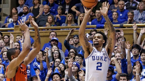 Duke's Gary Trent Jr. (2) shoot a three point basket while Virginia Tech's Nickeil Alexander-Walker defends during the first half of an NCAA college basketball game in Durham, N.C., Wednesday, Feb. 14, 2018. (AP Photo/Gerry Broome)