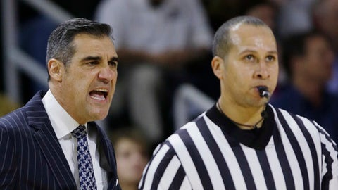 Villanova coach Jay Wright has words with a referee during the first half of the team's NCAA college basketball game against Providence on Wednesday, Feb. 14, 2018, in Providence, R.I. (AP Photo/Stephan Savoia)