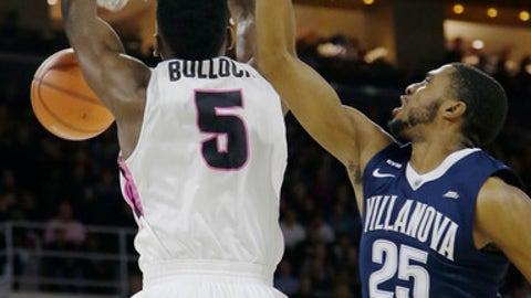 Providence forward Rodney Bullock (5) dunks against Villanova guard Mikal Bridges (25) during the first half of an NCAA college basketball game Wednesday, Feb. 14, 2018, in Providence, R.I. (AP Photo/Stephan Savoia)