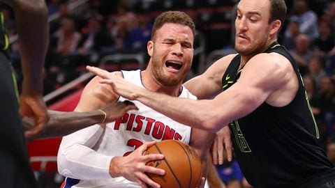 DETROIT, MI - FEBRUARY 14: Blake Griffin #23 of the Detroit Pistons tries to get a shot off past Miles Plumlee #18 of the Atlanta Hawks during the first half at Little Caesars Arena on February 14, 2018 in Detroit, Michigan. (Photo by Gregory Shamus/Getty Images)