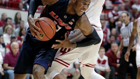 Illinois forward Leron Black (12) goes around Indiana forward Juwan Morgan during the first half of an NCAA college basketball game in Bloomington, Ind., Wednesday, Feb. 14, 2018. (AP Photo/Michael Conroy)