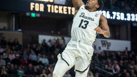 Wake Forest guard Bryant Crawford (13) drives to the basket against Georgia Tech during an NCAA college basketball game, Wednesday, Feb. 14, 2018 in Winston-Salem, N.C. (Andrew Dye/The Winston-Salem Journal via AP)