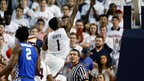 Auburn guard Jared Harper shoots and scores against Kentucky during the first half of an NCAA college basketball game on Wednesday, Feb. 14, 2018, in Auburn, Ala. (AP Photo/Brynn Anderson)