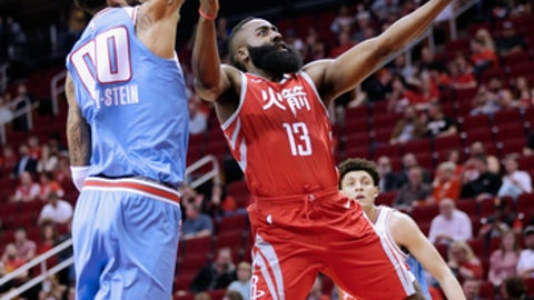 HOUSTON, TX - FEBRUARY 14:  James Harden #13 of the Houston Rockets drives by Willie Cauley-Stein #00 of the Sacramento Kings for a layup at Toyota Center on February 14, 2018 in Houston, Texas. (Photo by Bob Levey/Getty Images)