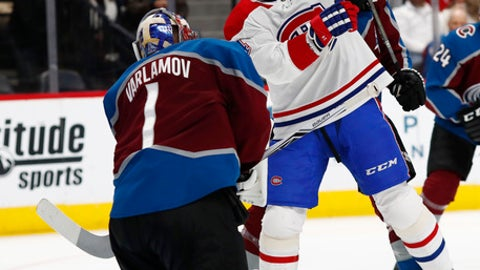 Colorado Avalanche goaltender Semyon Varlamov, left, stops a shot off the stick of Montreal Canadiens center Tomas Plekanec in the second period of an NHL hockey game Wednesday, Feb. 14, 2018, in Denver. (AP Photo/David Zalubowski)