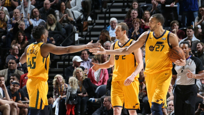 Jazz win 11th straight, beating Suns 107-97