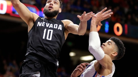 Nevada's Caleb Martin (10) goes up to the basket past Boise State's Chandler Hutchison during the second half of an NCAA college basketball game in Boise, Idaho, Wednesday, Feb. 14, 2018. Nevada won 77-72. (AP Photo/Otto Kitsinger)