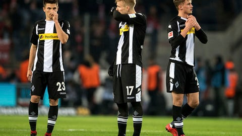 FILE - In this Jan. 14, 2018 file photo Moenchengladbach's Jonas Hofmann, Oscar Wendt and Mickael Cuisance, from left, react after the German Bundesliga soccer match between 1. FC Cologne and Borussia Moenchengladbach at the RheinEnergieStadion in Cologne, Germany. Three defeats in a row, four losses from five games since the Bundesliga resumed, and a long injury list have battered Borussia Moenchengladbachs confidence and put the sides goal of European qualification in danger. (Marius Becker/dpa via AP)