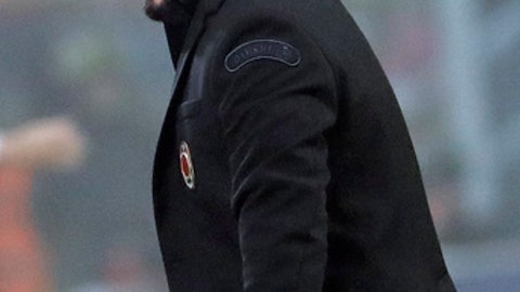 FILE - In this Jan. 28, 2018 file photo, AC Milan coach Gennaro Gattuso celebrates a 2-1 win at the end of a Serie A soccer match between AC Milan and Lazio, at the San Siro stadium in Milan, Italy. The bearded Gattuso is getting compliments as a coach as his rejuvenated Milan side has climbed up to seventh in the table, sparking talk it could still sneak into the Champions League. (AP Photo/Luca Bruno, files)