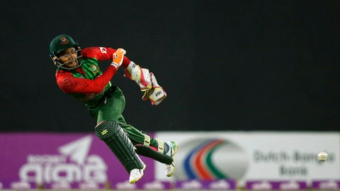 Bangladesh's wicketkeeper Mushfiqur Rahim throws the ball as he fields against Sri Lanka during the first Twenty20 international cricket match in Dhaka, Bangladesh, Thursday, Feb. 15, 2018. (AP Photo/A.M. Ahad)