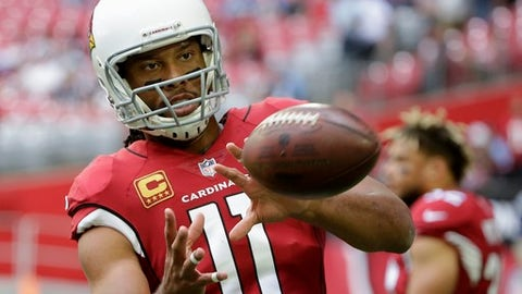 "FILE - In this Dec. 10, 2017, file photo, Arizona Cardinals wide receiver Larry Fitzgerald warms up prior to an NFL football game against the Tennessee Titans in Glendale, Ariz. New Arizona coach Steve Wilks says Fitzgerald has told him he'll return for a 15th NFL season. Wilks made the comment Thursday, Feb. 15, 2018, in an interview on the ""Doug &Wolf"" sports talk radio show. (AP Photo/Rick Scuteri, File)"