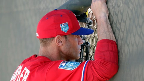 Philadelphia Phillies manager Gabe Kapler watches pitchers in the bullpen at baseball spring training, Thursday, Feb. 15, 2018, in Clearwater, Fla. (AP Photo/Lynne Sladky)