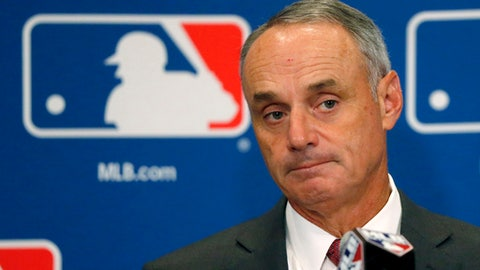 FILE - In this Aug. 17, 2017, file photo, Commissioner Rob Manfred listens to a question following the two-day meeting of Major League Baseball owners in Chicago. Baseball Commissioner Rob Manfred says proposed rules changes to speed pace of play with be in place by the start of big league exhibition games on Feb. 23, 2018. Speaking Thursday, Feb. 15, 2018 at Tropicana Field, Manfred says one way or the other'' there will be rule changes. (AP Photo/Charles Rex Arbogast, File)