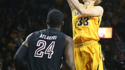 Wichita State guard Conner Frankamp shoots over Temple center Ernest Aflakpui during the first half of an NCAA college basketball game Thursday, Feb. 15, 2018, in Wichita, Kan. (Travis Heying/The Wichita Eagle via AP)