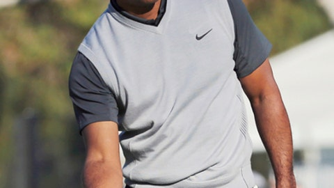 Tiger Woods tries to coax a putt on the 14th green during the first round of the Genesis Open golf tournament at Riviera Country Club in the Pacific Palisades neighborhood of Los Angeles on Thursday, Feb. 15, 2018. (AP Photo/Reed Saxon)