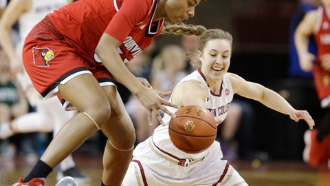 Louisville forward Bionca Dunham (33) moves in to scoop up a loose ball just before Boston College guard Rachel Gartner (5) can get to it during the second half of their NCAA college basketball game Thursday, Feb. 15, 2018, in Boston. Louisville defeated Boston College 87-52. (AP Photo/Stephan Savoia)